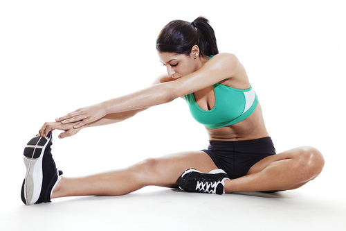 Young woman seated hamstring stretch